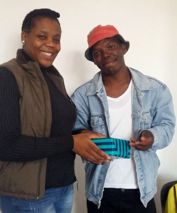 Winner in Joburg receiving his camera from Mpho Molebatsi from SSA